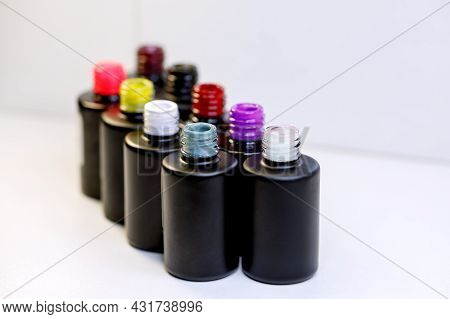 Multi-colored Gel Varnishes For Manicure And Pedicure Close-up. Materials For A Beauty Salon. Colore