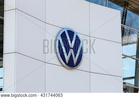 Round Volkswagen Logo On Outside White Building Wall At Daylight - Tula, Russia, 08 30 2021