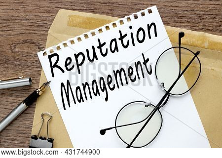 Reputation Management, Craft Notebook On Wood Table With Text On Paper And Pen