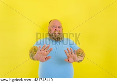 Doubter Man With Beard And Tattoos Has Doubt About Something