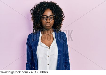 Young african american woman wearing business clothes and glasses depressed and worry for distress, crying angry and afraid. sad expression.