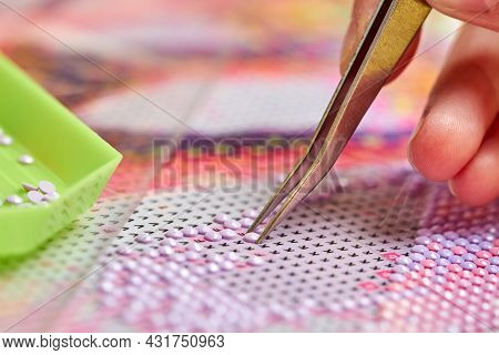 Girl Collect Diamond Painting. Diamond Embroidery With A Tweezers. Acrylic Rhinestones. Close-up, Se