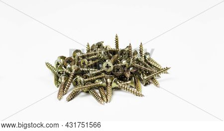 Screw. Self-tapping Screw. A Bunch Of Cogs. On White Background.