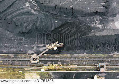 Large Reserves Of Coal At A Power Plant, Many Cranes Unloading Coal, A Lot Of Coal, Top View