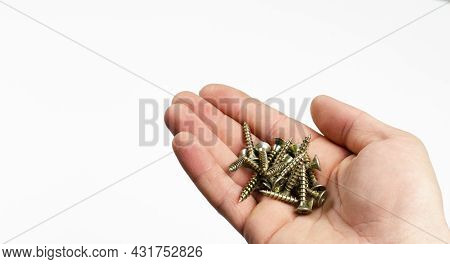 Screw. Self-tapping Screw. On White Background. In Hand.