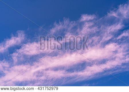 Pink Sunset Clouds In A Blue Sky. Nature Cloudscape .