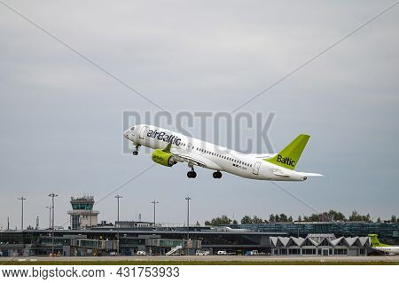 Riga, Latvia - August 31, 2021: Airbaltic Airbus A220-300 Yl-aas Takes Off From Rix International Ai