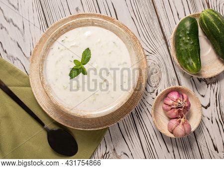 Greek Tzatziki Sauce On A Gray Background. Traditional Indian Raita With Cucumber, Greek Yogurt And