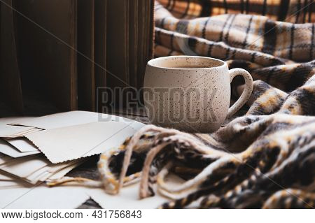 Atmospheric Autumn Or Fall Hot Coffee. Mug Of Cacao With Cozy Brown Plaid And Old Vintage Photos. Su