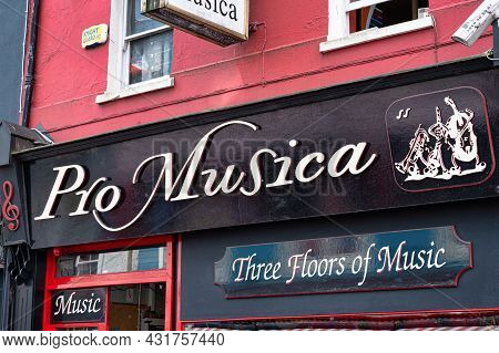 Cork, Ireland- July 14, 2021: The Sign For Pro Musica Musical Instrument Store  In Cork City