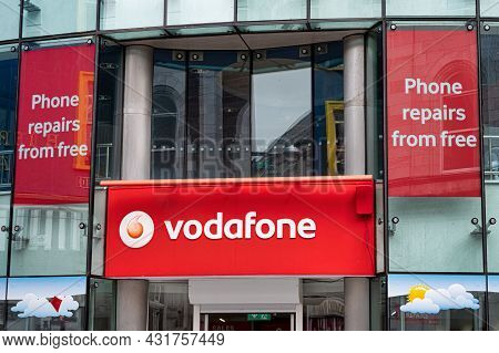 Cork, Ireland- July 14, 2021: The Sign For Vodafone Store In Cork City