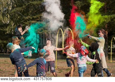 Russia, Naberezhnye Chelny, August 28, 2021: Children And Adults Throw Holi Colored Paints At Each O