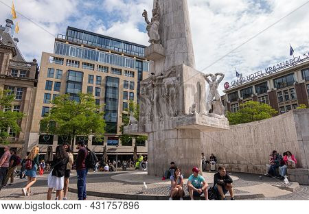 Amsterdam, Netherlands - August 14, 2021: White National Monument Under Heavy Blue Cloudscape. Busin