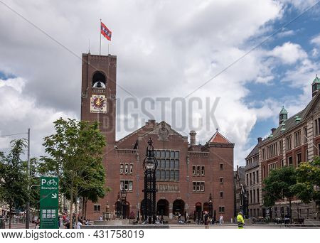 Amsterdam, Netherlands - August 14, 2021: Red-brown Brick Stone Stock Exchange Building With Clock T