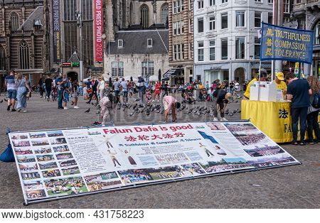 Amsterdam, Netherlands - August 14, 2021: Falun Dafa Info Booth Distributes Flyers And Signatures Ag
