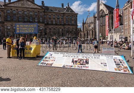 Amsterdam, Netherlands - August 14, 2021: Falun Gong Info Booth Distributes Flyers And Signatures Ag