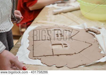 Womens Hands Knead Clay, Drawing Elements Of The Product. Production Of Ceramic Products At The Mast
