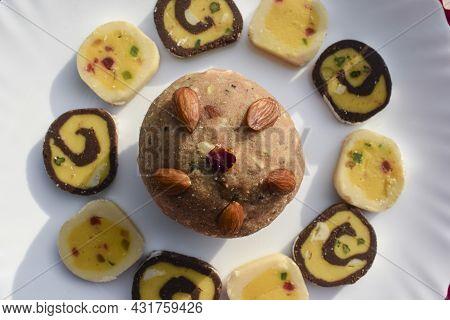 Indian Sweets Wheat Or Atta Laddu, Chocolate Barfi, Tutti Fruity Burfi Arranged On White Background.