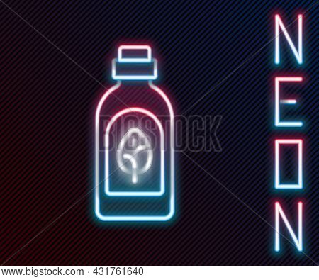 Glowing Neon Line Essential Oil Bottle Icon Isolated On Black Background. Organic Aromatherapy Essen