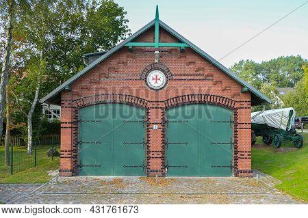 Wustrow, Germany, August 31, 2021: Garage House With Logo Sign Of The Deutsche Gesellschaft Zur Rett