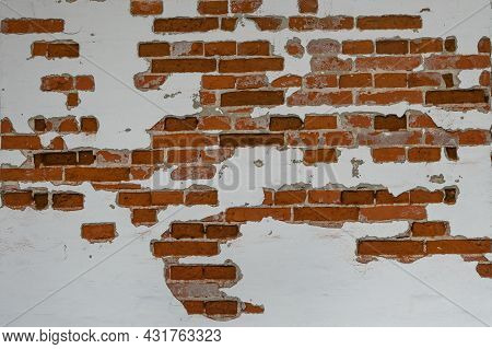 Old Red Brick Wall Partially Plastered And White Painted, Background Texture For Historical Architec
