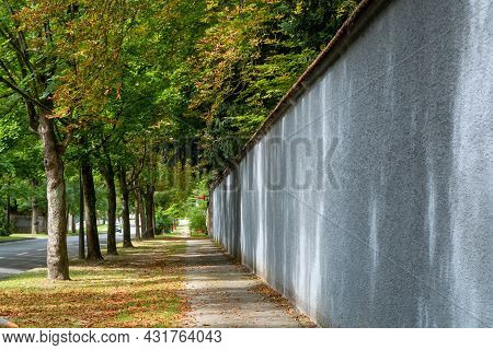 Walking Along The Walls Of Champagne House In Old French City Reims In August, Champagne, France