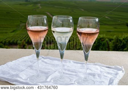 Glasses Of White And Rose Brut Champagne Wine And View On Grand Cru Vineyards Of  Montagne De Reims