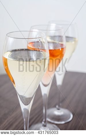 Tasting Of White And Rose Champagne Sparkling Wine From Flute Glasses