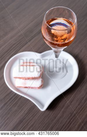 Symbols Of Reims On Heart Shaped Board - Glass Of Rose Brut Champagne And Rose Biscuits