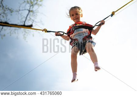 Child Jumping Child Trampoline Rubber Bands Amusement Park Little Girl Jump On Attraction