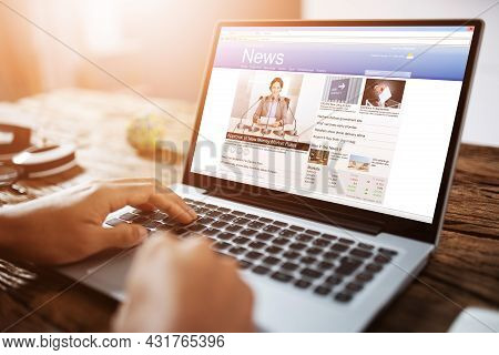 News Media Article Online On Laptop Computer