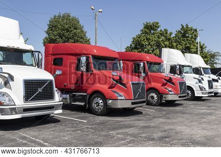 Indianapolis - Circa September 2021: Volvo Semi Tractor Trailer Trucks Lined Up For Sale. Volvo Is O