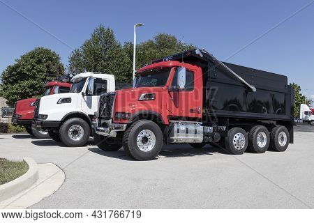 Indianapolis - Circa September 2021: Volvo Vhd Vocational Trucks And Off-highway Semi Trucks Lined U