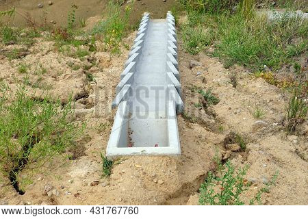 Construction Of The Highway. A System Of Concrete Modules For Draining Excess Water From The Road Su