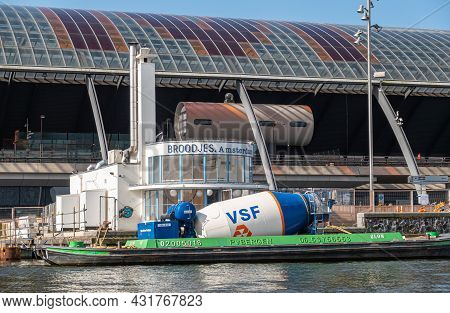 Amsterdam, Netherlands - August 15, 2021: Closeup Of Blue-white Cement Mill Installed On Barge Docke