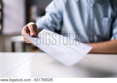 Hand Giving Payment Check Or Compensation Cheque
