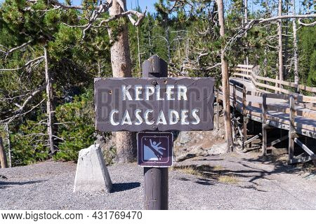 Keplar Cascades Waterfall In Yellowstone National Park - Sign