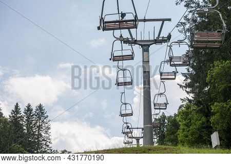 Selective Blur On Stopped Ski Lifts, Not Working In Summer, In A Ski Resort, By Slopes, In The Middl