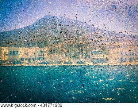Melancholy coastal view seen through a window boat, Greece island, cyclades, Travel background