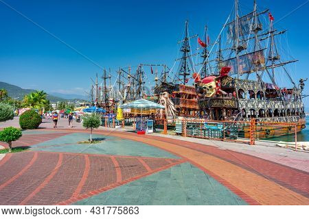 Alanya, Turkey - July 21, 2021: Pirate ships for tourists in the port of Alanya on the Mediterranean Sea, Turkey