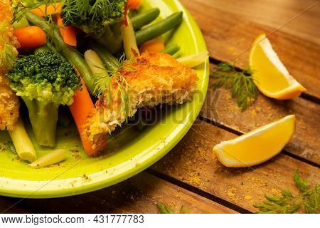 fried fish fillets served with vegetables, main dish, low fat diet, healthy lifestyle and eating