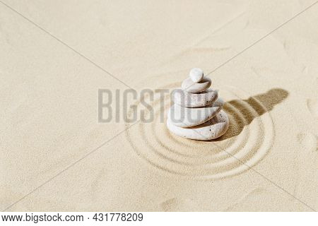 Zen Garden Meditation Sandy Background With Stone Cairn And Round Lines On Sand For Relaxation Balan