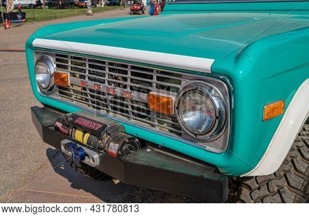 Loveland, CO, USA - August 29, 2021: The grille of vintage, first generation,  Ford Bronco ranger wagon with an upgraded front bumper and winch. This legendary model was manufactured in 1972-1976.