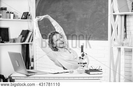 Stretching After Hard Working Day. Teacher Adorable Woman Try To Relax In Classroom. Mental Health A
