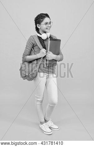 Modern Technologies In Education. Happy Child Back To School. Little Girl Wear Headphones. Modern Li