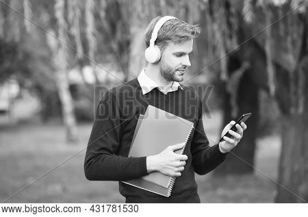 Reading Text Message. Guy Hold Notebook For Making Notes. Get Useful Information. Man Enjoy Reading.