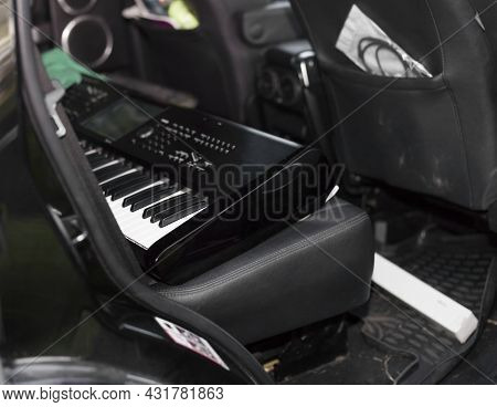 A Synthesizer On A Backseat Of A Messy Car, Shallow Dof