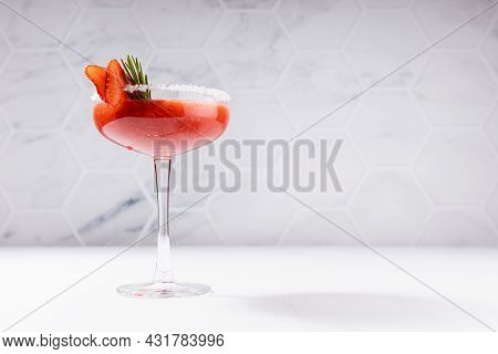 Cold Fresh Organic Smoothies Of Ripe Strawberry In High Glass With Sugar Rim, Green Rosemary Twig, F