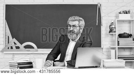 The Teacher The Legend. Senior Teacher Sit At School Desk. School Teacher Or Tutor. Schoolmaster. Te
