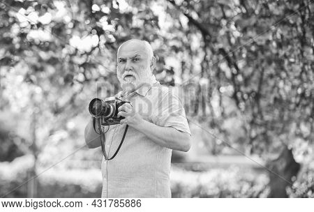 Travel Concept. Male Photographer Enjoy Cherry Blossom. Travel And Walking In Cherry Blossom Park. H